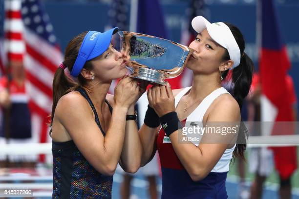 Martina Hingis of Switzerland and YungJan Chan of Taiwan kiss the championship trophy after defeating Lucie Hradecka of Czech Republic and Katerina...