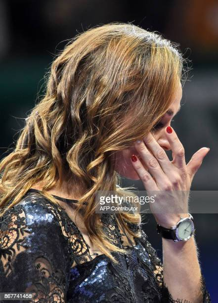 Martina Hingis of Switzerland attends her retirement ceremony at the WTA Finals tennis tournament in Singapore on October 29 2017 / AFP PHOTO /...