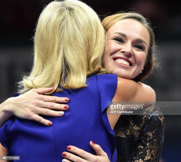 Martina Hingis of Switzerland gets a hug during her retirement ceremony at the WTA Finals tennis tournament in Singapore on October 29 2017 / AFP...