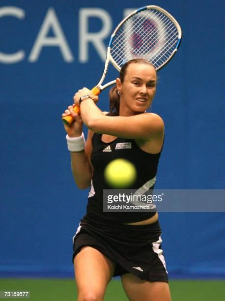 Martina Hingis of Switzerland hits a return against Nicole Pratt of Australia during the Toray Pan Pacific Open Tennis Tournament January 31 2007 in...