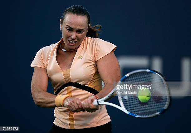 Martina Hingis of Switzerland hits a return shot against Kim Clijsters of Belgium during their match on Day 5 of the Acura Classic August 4 2006 at...