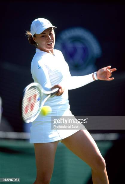Martina Hingis of Switzerland in action during the Wimbledon Lawn Tennis Championships at the All England Lawn Tennis and Croquet Club circa June...