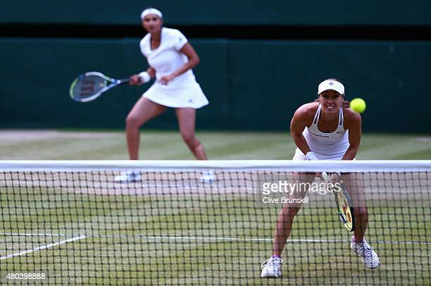 Martina Hingis of Switzerland in action playing with Sania Mirza of India in the Final Of The Ladies' Doubles against Ekaterina Makarova of Russia...