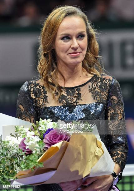 Martina Hingis of Switzerland looks on during her retirement ceremony at the WTA Finals tennis tournament in Singapore on October 29 2017 / AFP PHOTO...