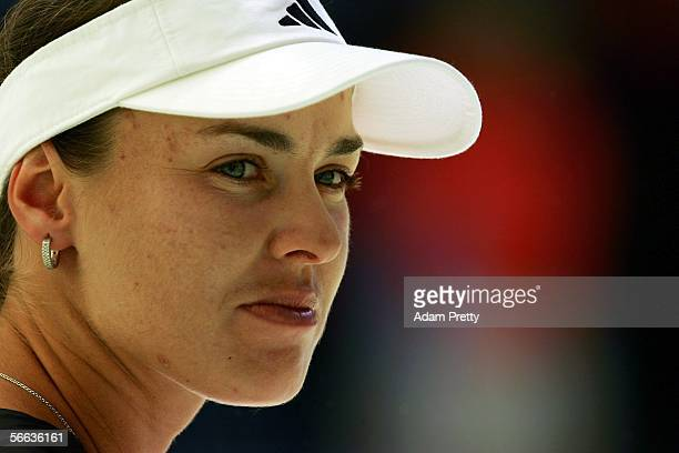 Martina Hingis of Switzerland looks on in her third round match against Iveta Benesova of the Czech Republic during day six of the Australian Open at...