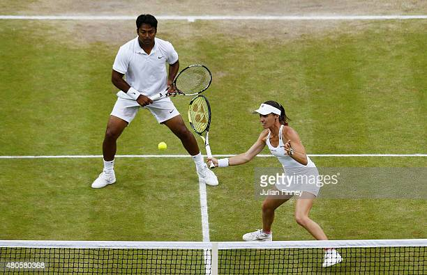 Martina Hingis of Switzerland playing with Leander Paes of India in action in the Final Of The Mixed Doubles against Timea Babos of Hungary and...