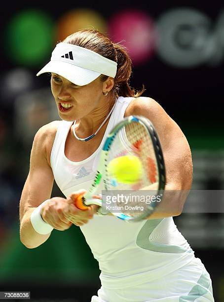 Martina Hingis of Switzerland plays a backhand during her quarterfinal match against Kim Clijsters of Belgium on day ten of the Australian Open 2007...