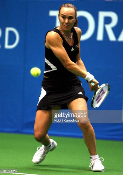 Martina Hingis of Switzerland plays a backhand during her semifinal women's singles match against Elena Dementiva of Russia at the Toray Pan Pacific...