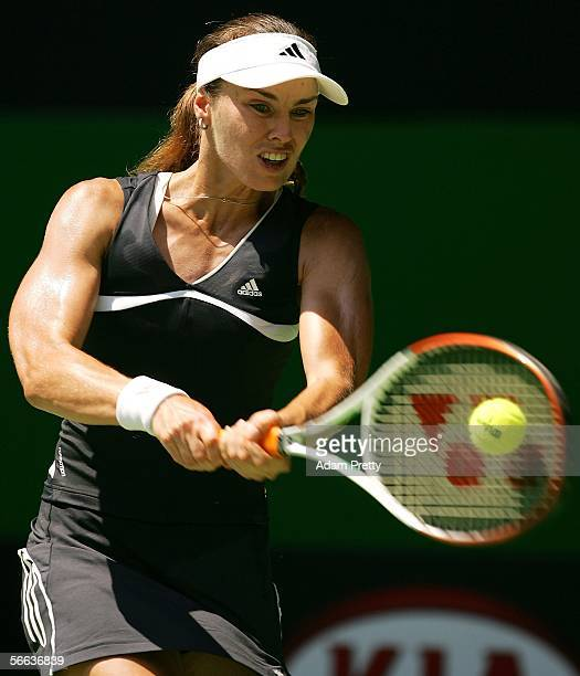 Martina Hingis of Switzerland plays a backhand in her third round match against Iveta Benesova of the Czech Republic during day six of the Australian...