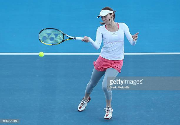 Martina Hingis of Switzerland plays a forehand in her exhibition match with Belinda Bencic of Switzerland during day one of the Moorilla Hobart...