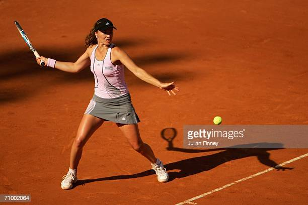 Martina Hingis of Switzerland plays a forehand in her match against Dinara Safina of Russia in the final during the WTA Masters Series at Foro...