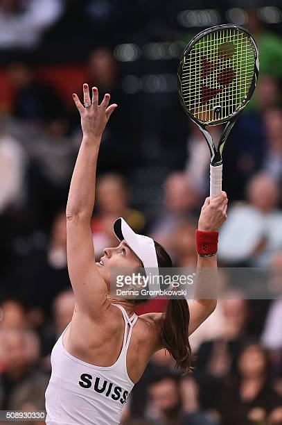Martina Hingis of Switzerland plays a serves in her double match with Belinda Bencic on Day 2 of the 2016 FedCup World Group Round 1 match between...