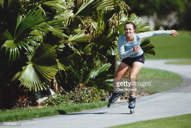 Martina Hingis of Switzerland poses for a portrait on rollerblades for sports clothing accessories company Adidas on 4 April 2001 at the Saddlebrook...