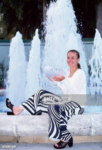Martina Hingis of Switzerland poses with her trophy in front of a fountain after defeating Lindsay Davenport of the USA in the Women's Singles Final...