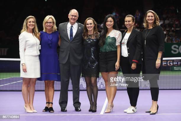 Martina Hingis of Switzerland poses with Melissa Pine WTA Finals Tournament Director Micky Lawler WTA President Steve Simon WTA CEO Chan YungJan of...