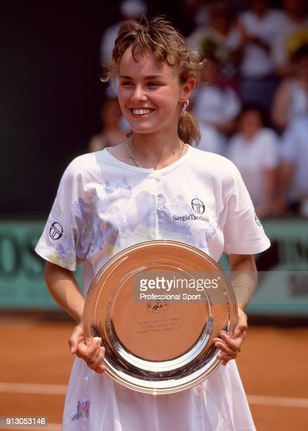 Martina Hingis of Switzerland poses with the trophy after defeating Laurence Courtois of Belgium in the Junior Girls' Final of the French Open Tennis...