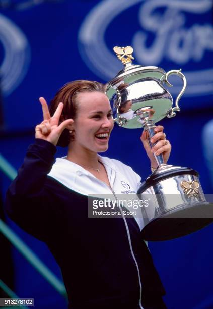 Martina Hingis of Switzerland poses with the trophy after defeating Amelie Mauresmo of France in the Women's Singles Final of the Australian Open...