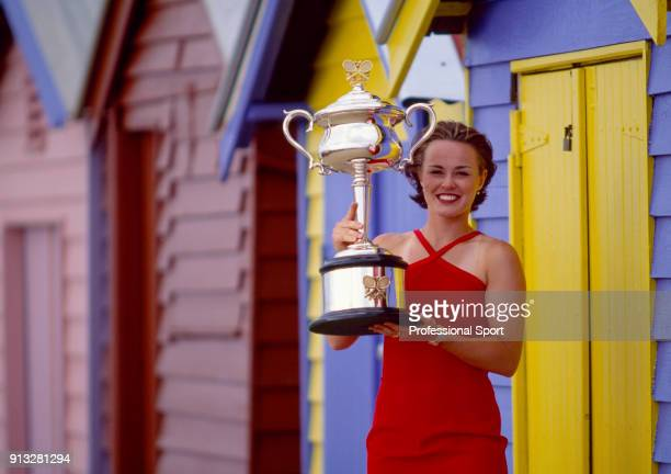 Martina Hingis of Switzerland poses with the trophy at Brighton Beach after defeating Amelie Mauresmo of France in the Women's Singles Final of the...
