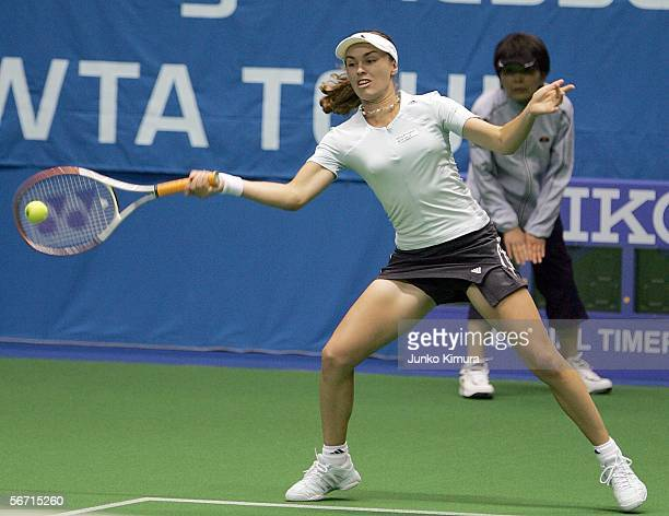 Martina Hingis of Switzerland returns the ball against YoonJeong Cho during the Toray Pan Pacific Open February 1 2006 in Tokyo Japan