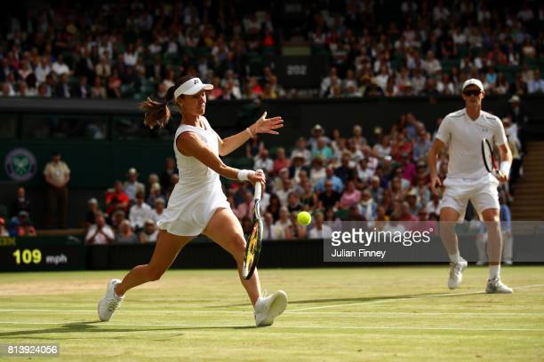 Martina Hingis of Switzerland returns with Jamie Murray of Great Britain during the Mixed Doubles quarter final match against Ken Skupski of Great...