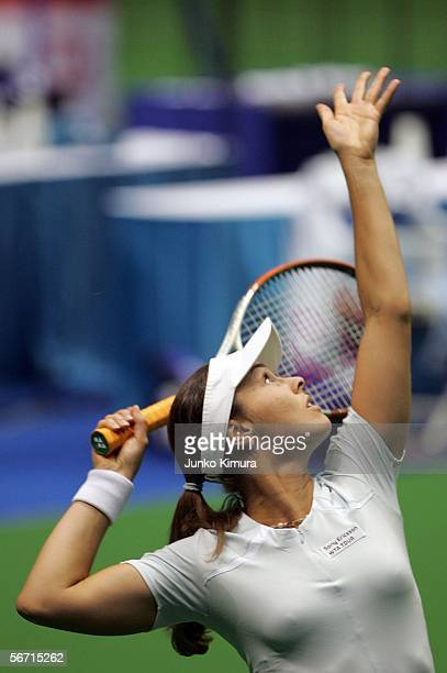 Martina Hingis of Switzerland serves against YoonJeong Cho during the Toray Pan Pacific Open February 1 2006 in Tokyo Japan