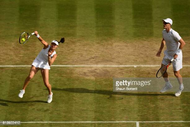 Martina Hingis of Switzerland smashes with Jamie Murray of Great Britain during the Mixed Doubles quarter final match against Ken Skupski of Great...
