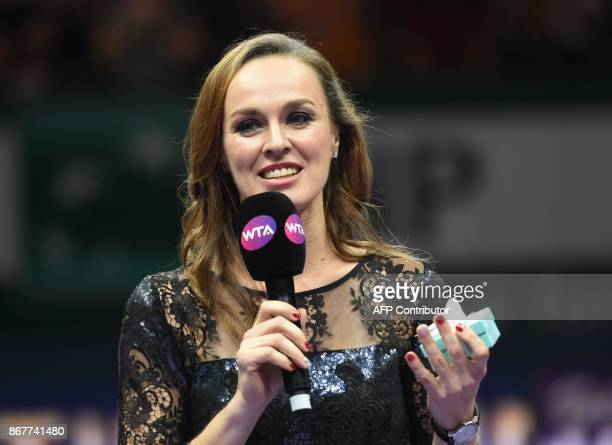 Martina Hingis of Switzerland talks during her retirement ceremony at the WTA Finals tennis tournament in Singapore on October 29 2017 / AFP PHOTO /...