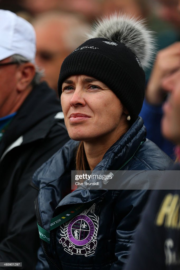 Martina Hingis of Switzerland watches the women's singles match between Sabine Lisicki of Germany and Fiona Ferro of France on day two of the French Open at Roland Garros on May 26, 2014 in Paris, France.
