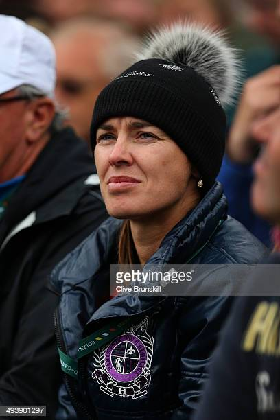 Martina Hingis of Switzerland watches the women's singles match between Sabine Lisicki of Germany and Fiona Ferro of France on day two of the French...