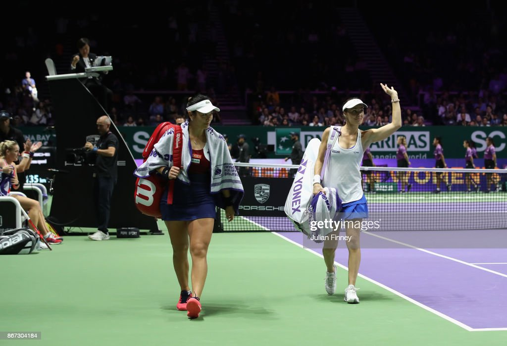 Martina Hingis (R) of Switzerland waves to the crowd in her final tournament with Chan Yung-Jan of Chinese Taipei after their defeat in the doubles semi final match against Andrea Hlavackova of Czech Republic and Timea Babos of Hungary during day 7 of the BNP Paribas WTA Finals Singapore presented by SC Global at Singapore Sports Hub on October 28, 2017 in Singapore.