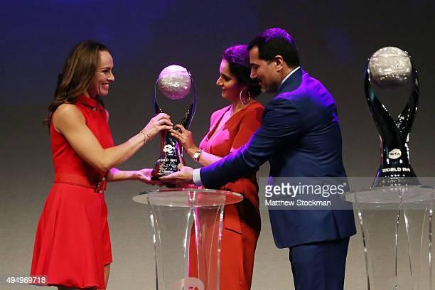 Martina Hingis Sania Mirza and Dubai Duty Free Tennis Tournament director Salah Tahlak on stage at Singapore Tennis Evening during BNP Paribas WTA...