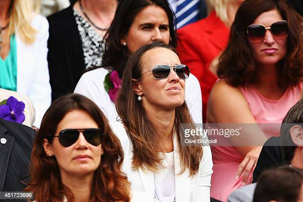 Martina Hingis sits in the Royal Box on Centre Court before the Ladies' Singles final match between Eugenie Bouchard of Canada and Petra Kvitova of...