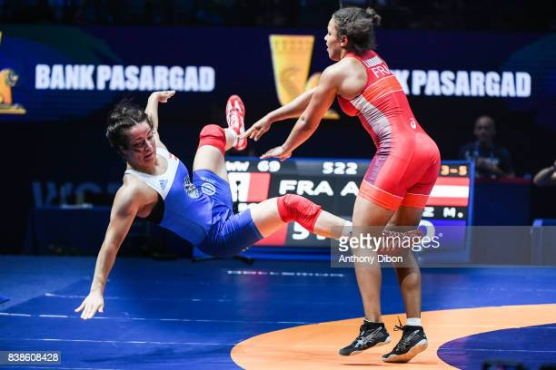 Martina Kuenz and Koumba Larroque 69kg during the female wrestling competition during the Paris 2017 Women's World Championships at AccorHotels Arena...