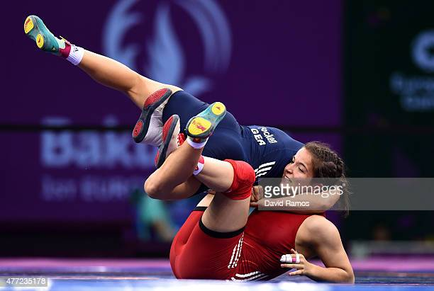 Martina Kuenz of Austria and Aline Focken of Germany compete in the Women's Freestyle 69kg Wrestling Bronze Final during day three of the Baku 2015...