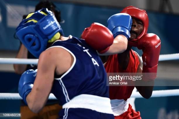 Martina La Piana of Italy fights with Adijat Gbadamosi of Nigeria in Women's Fly Gold Medal Boutduring day 12 of Buenos Aires 2018 Youth Olympic...