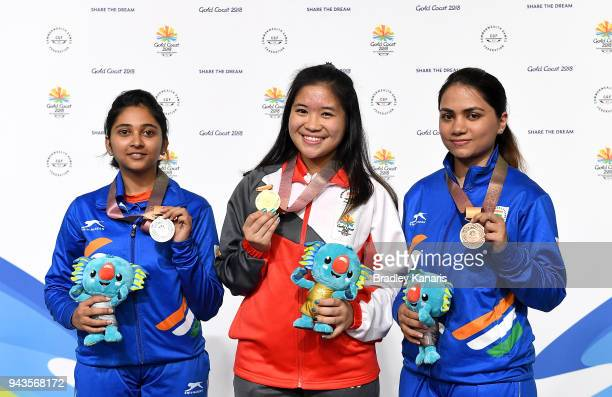 Martina Lindsay Veloso of Singapore wins gold with Mehuli Ghosh of India winning silver in the Women's 10m Air Rifle during Shooting on day five of...