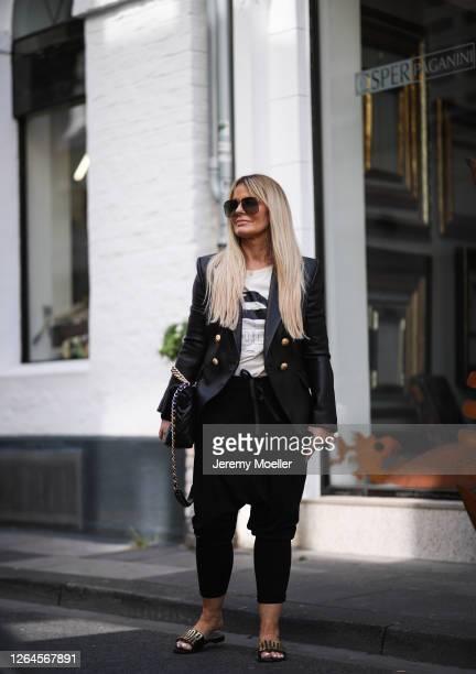 Martina Maturi wearing Balmain blazer Chanel bag Dior sandals Sophie Schnoor shirt and Zara pants on August 07 2020 in Cologne Germany