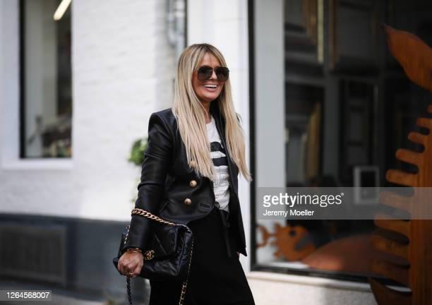 Martina Maturi wearing Balmain blazer Chanel bag Sophie Schnoor shirt and Zara pants on August 07 2020 in Cologne Germany