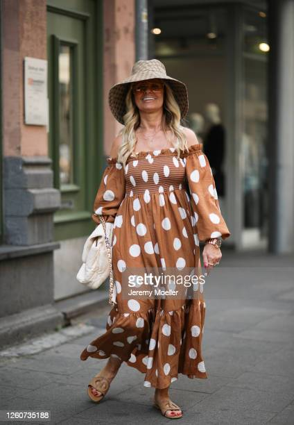 Martina Maturi wearing Chanel bag, H&M dress, Gucci shades, Dior shoes and Gucci hat on July 24, 2020 in Cologne, Germany.