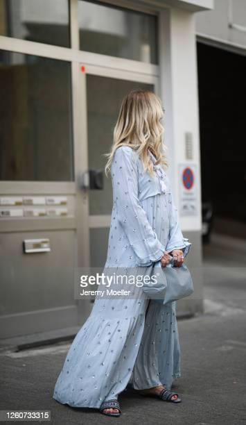 Martina Maturi wearing Dior sandals, Bottega Veneta bag, Gucci shades, Sundress dress on July 24, 2020 in Cologne, Germany.