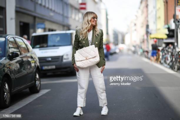 Martina Maturi wearing Dior sneaker Chanel bag Gucci shades Balmain blazer Anine Bing shirt and Zara pants on July 24 2020 in Cologne Germany