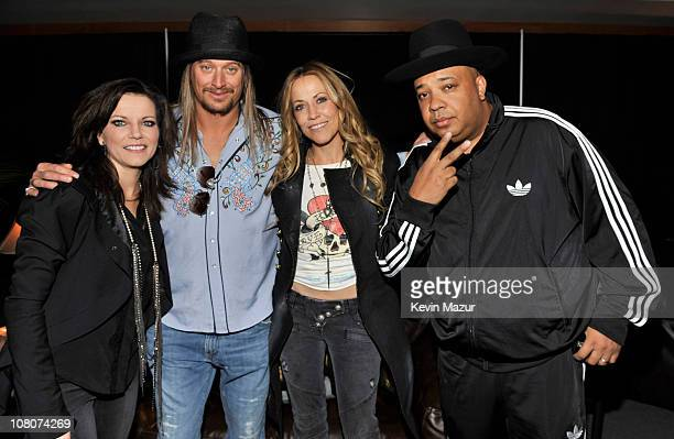 """Martina McBride, Kid Rock, Sheryl Crow and Joseph """"Rev Run"""" Simmons backstage at Ford Field on January 15, 2011 in Detroit, Michigan."""