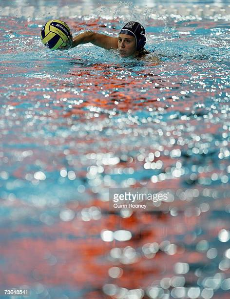 Martina Miceli of Italy swims to retrieve the ball in the Women's Preliminary Round Group D Water Polo match between Cuba and Italy at the Melbourne...