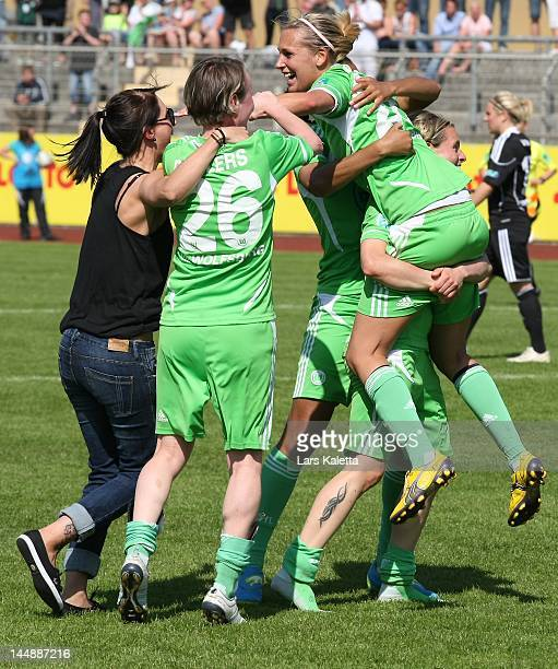 Martina Müller Lena Goeßling and Conny Pohlers of VfL Wolfsburg celebrate after the Women's Bundesliga match between VfL Wolfsburg and 1 FFC...