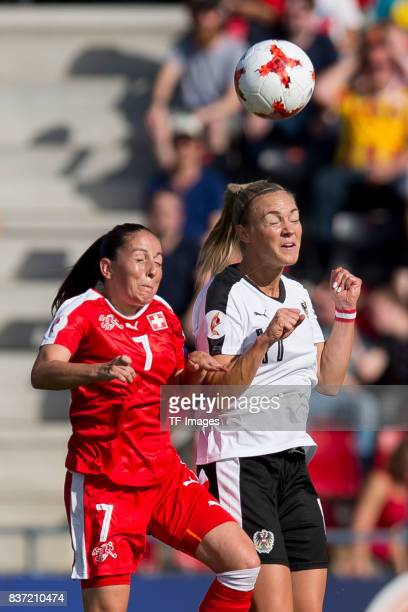 Martina Moser of Switzerland and Sarah Puntigam of Austria battle for the ball during the Group C match between Austria and Switzerland during the...