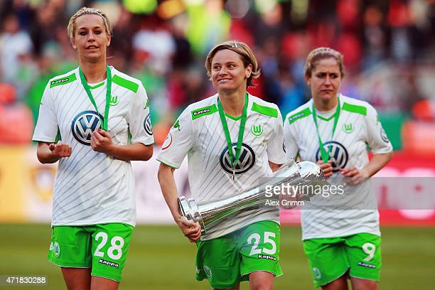 Martina Mueller Lena Goessling and Anna Blaesse of Wolfsburg celebrate with the trophy after winning the Women's DFB Cup Final between Turbine...