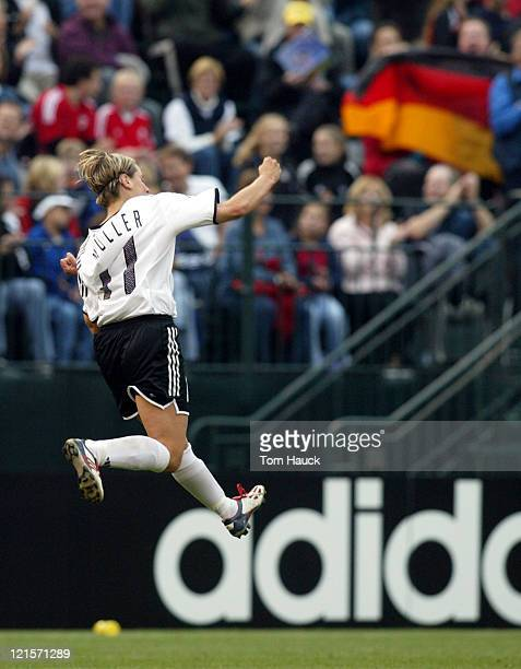 Martina Mueller of Germany celebrates her goal during game action with Russia October 2 at PGE Park in Portland Oregon Germany defeated Russia 71 in...