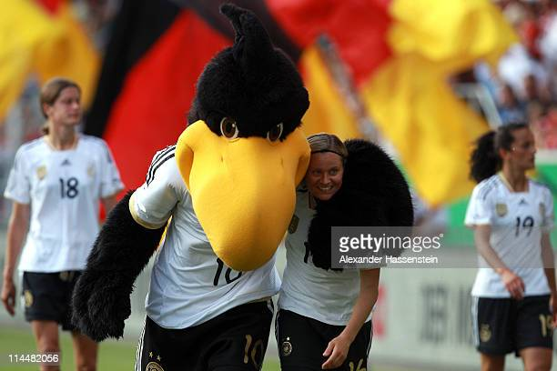 Martina Mueller of Germany celebrates with team mascot Paule after winning the International friendly match between Germany and DPR Korea at Audi...