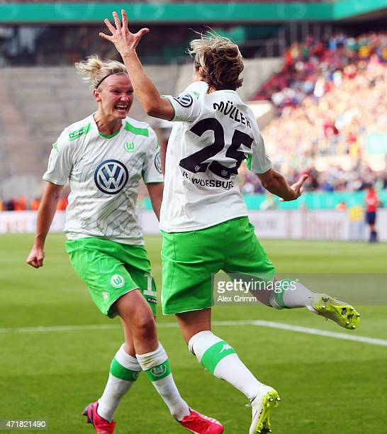 Martina Mueller of Wolfsburg celebrates her team's second goal with team mate Alexandra Popp during the Women's DFB Cup Final between Turbine Potsdam...