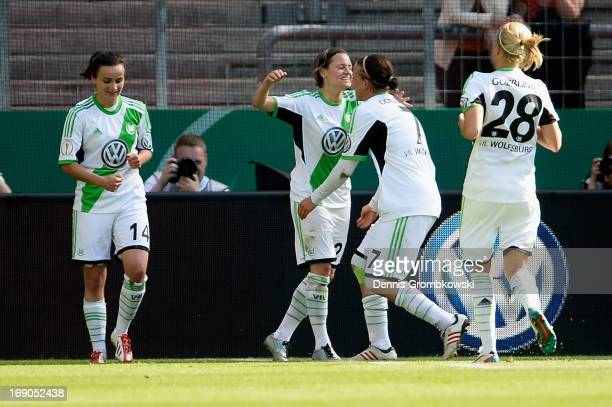 Martina Mueller of Wolfsburg celebrates with teammates after scoring his team's first goal during the Women's DFB Cup Final between VfL Wolfsburg and...